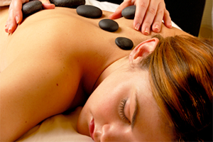 Hot stone massage on woman