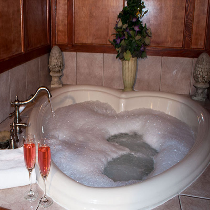 Water running in tub for two at The Gables Inn