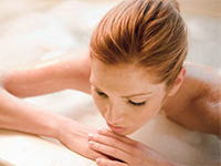 Woman in tub at a spa