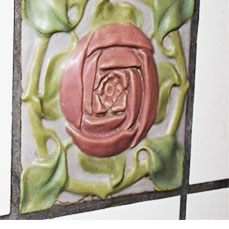Rose tile on fireplace at The Gables Inn