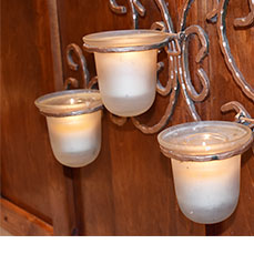 Three tier candles burning at The Gables Inn