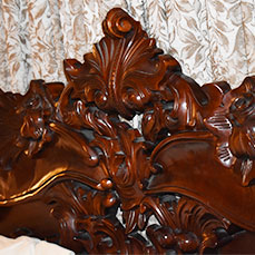 Ornate Mahogany bed at The Gables Inn